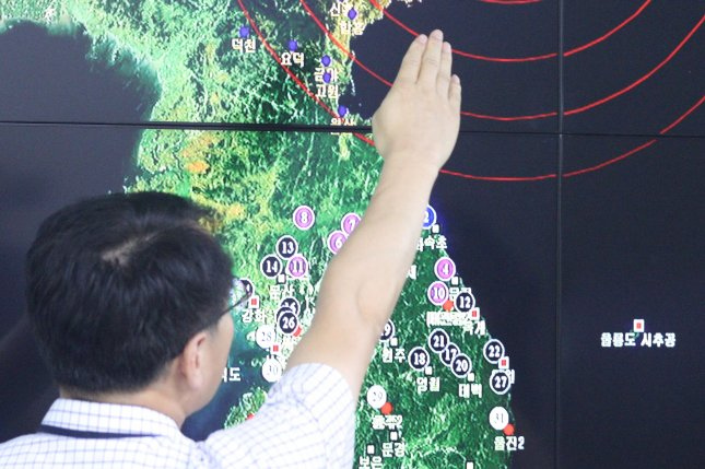 A South Korean official points to North Korea's northeastern county of Kilju, where the country conducted its fifth nuclear test on Sept. 9. South Korea is purchasing more weapons in response to increased North Korea provocations. Photo by Yonhap/UPI