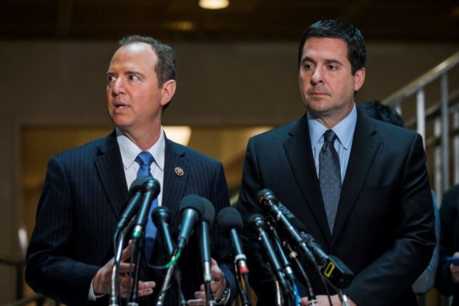 House Intelligence Committee Chairman Devin Nunes (R) and ranking Democrat Adam Schiff talk to reporters at the U.S. Capitol on Wednesday, saying they have found no evidence to support President Donald Trump's assertion that Trump Tower was wiretapped before the election. Photo by Jim Lo Scalzo/EPA