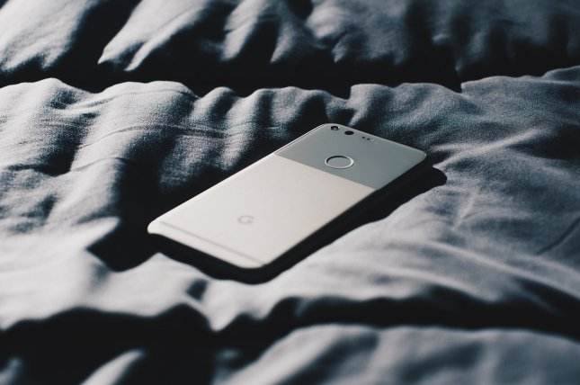 A small study suggests that device usage -- regardless of smartphone, tablet or laptop -- can be detrimental to sleep quality. Photo by StockSnap/Pixabay