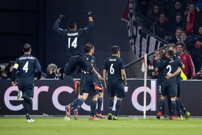 Players of Real Madrid celebrate the 1-0 goal of Karim Benzema during the UEFA Champions League round of 16 first leg soccer match between Ajax Amsterdam and Real Madrid on Wednesday in Amsterdam, Netherlands. Photo by Olaf Kraak/EPA-EFE