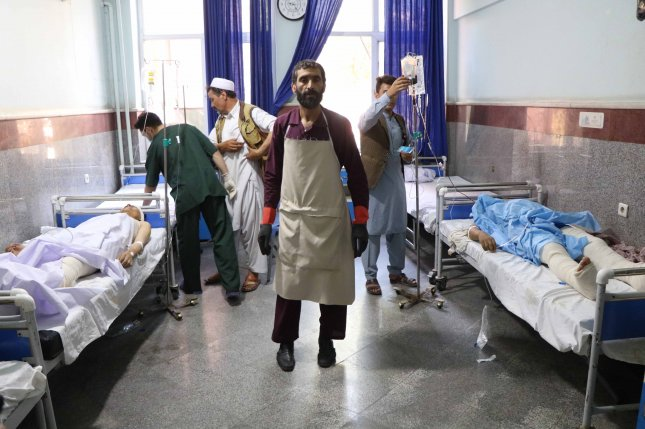 Passengers injured by the roadside bomb receive medical treatment Wednesday at a hospital in Herat, Afghanistan. Photo by Jalil Rezayee/EPA-EFE