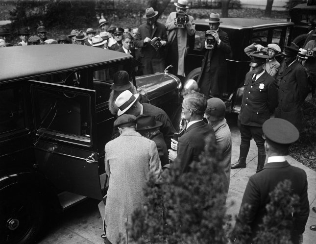 Albert B. Fall, former Secretary of Interior, being helped into his car as he leaves the District and Supreme Court in Washington, D.C., on Oct. 25, 1929. Fall was found guilty of accepting a bribe of $100,000 from E.L. Doheny as part of the Teapot Dome Scandal. File Photo by Library of Congress/UPI