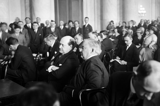 Harry F. Sinclair, multimillionaire oil magnate (left) and his counsel Martin W. Littleton during hearing on the Teapot Dome scandal in 1924. File Photo by Library of Congress/UPI