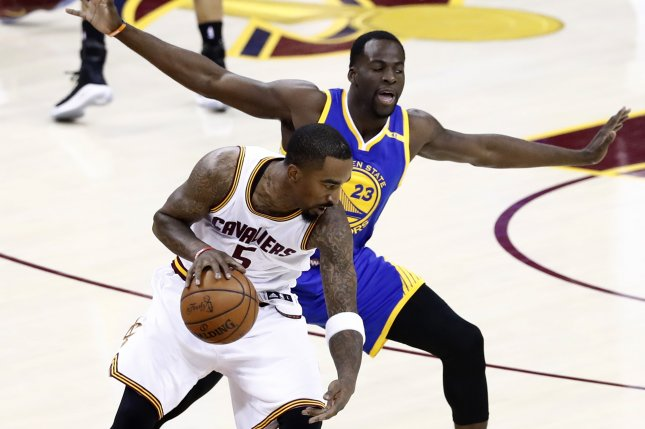 Cleveland Cavaliers guard J.R. Smith (L) and Golden State Warriors forward Draymond Green (R) in action in the first half of Game 3 of the NBA Finals Wednesday at Quicken Loans Arena in Cleveland, Ohio. Photo by Larry W. Smith/EPA
