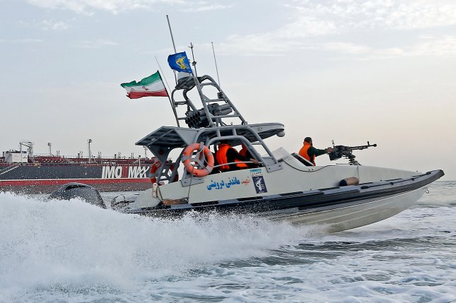 An Iranian Revolutionary Guard jet boat sails around a seized tanker in Bandar Abbas, southern Iran, on July 21. Last week, Iran seized another foreign tanker in the Persian Gulf, state-run media reported Sunday. Photo by Hasan Shirvani/EPA
