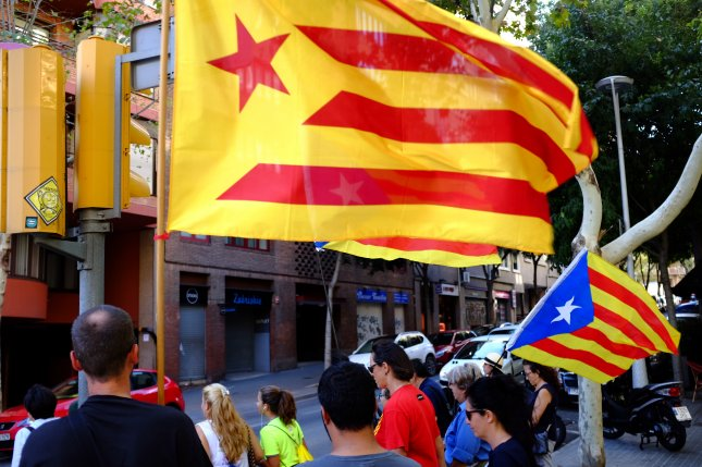 Protesters in Barcelona wave Catalonian flags en route to a demonstration in favor of the region's independence. The Spanish government has said the planned referendum is unconstitutional and promised to block it from taking place. Photo by Eric DuVall/UPI
