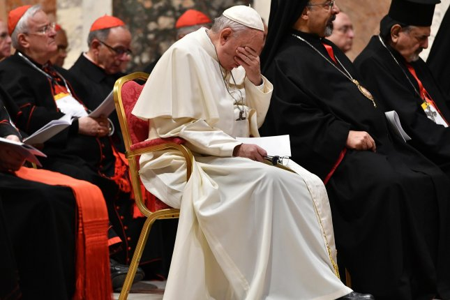 Pope Francis (C) reacts as he takes part in a liturgical prayer during a Vatican summit on tackling pedophilia in the clergy last month. A new Gallup survey shows that more Catholics are questioning whether they should remain with the church. Photo by Vincenzo Pinto/EPA-EFE