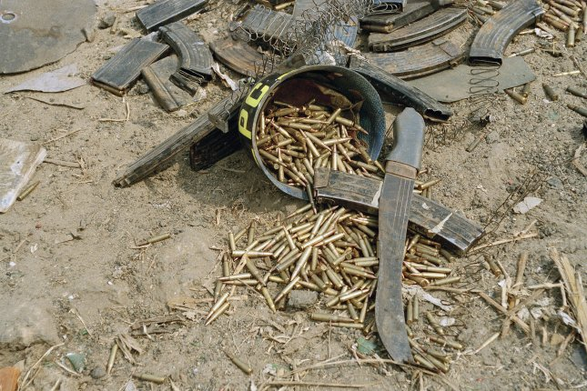 Machetes and bullets are seen in Gisenyi, Rwanda, on July 26, 1994, during the mass Tutsi genocide. File Photo by John Isaac/United Nations