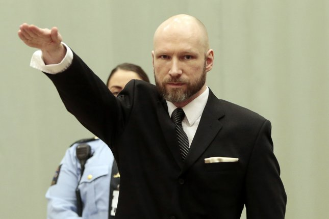 Convicted mass murderer Anders Behring Breivik raises his right arm in a Nazi salute in the Borgarting Court of Appeal at Telemark prison in Skien, Norway, on January 10, 2017. File Photo by Lise Asserud/EPA