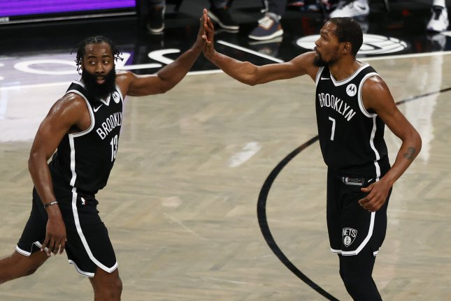Brooklyn Nets guard James Harden (L), forward Kevin Durant (R) and guard Kyrie Irving combined for 96 points in a loss to the Cleveland Cavaliers on Wednesday in Cleveland. Photo by Jason Szenes/EPA-EFE