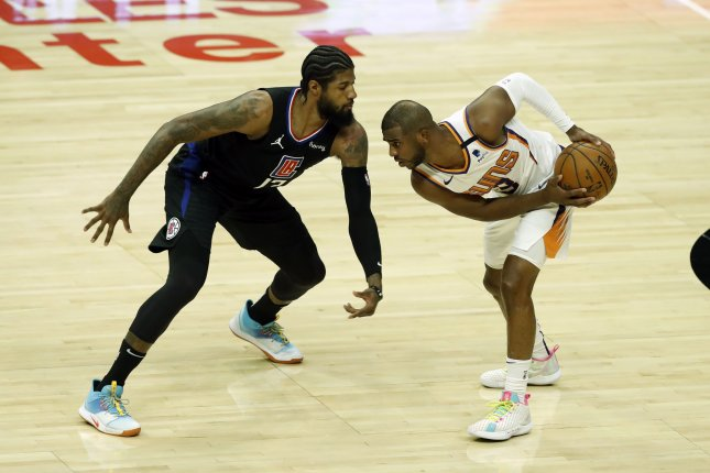 Phoenix Suns guard Chris Paul (R), shown April 8, 2021, has been in the NBA's COVID-19 health and safety protocols since last week after testing positive for the coronavirus. File Photo by Etienne Laurent/EPA-EFE