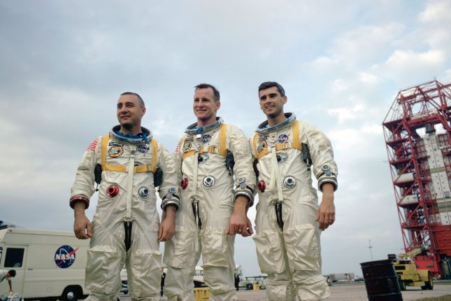 The prime crew of NASA's first manned Apollo Space Flight -- Virgil I. Grissom, Edward H. White II and Roger B. Chaffee--are pictured at the Kennedy Space Center in Florida in 1966. All three died during a pre-launch test in January 1967. File Photo courtesy of NASA