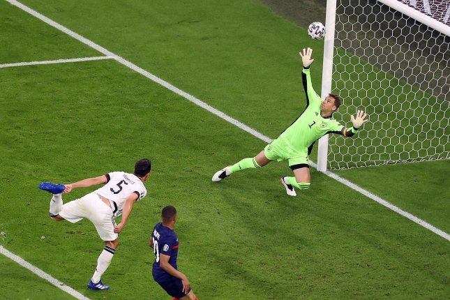 Mats Hummels (L) scored an own goal against star goalie Manuel Neuer (R) in the first half of a UEFA Euro 2020 Group F match against France on Tuesday in Munich, Germany. Photo by Alexander Hassenstein/EPA-EFE