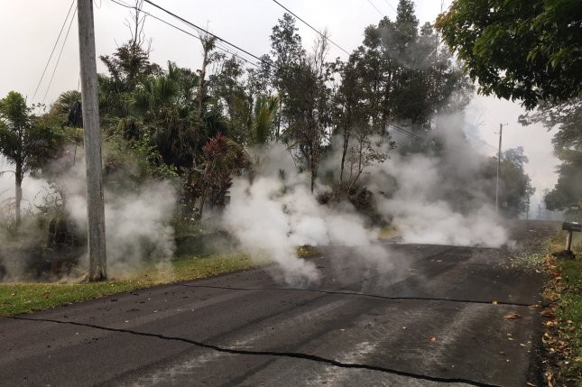 Steam rises from a fissure in the Leilani Estates subdivision, near Pahoa, Hawaii, on Monday. County officials said that while lava is no longer coming out of the fissures, some residents in danger zones will be allowed to check on their property. Photo by USGS/EPA-EFE