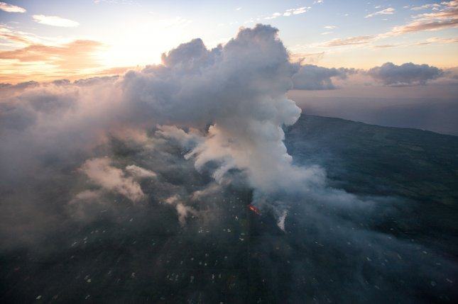 A new eruption at Kilauea Volcano prompted an ashfall warning from the National Weather Service on Tuesday. Photo by Bruce Omori/Paradise Helicopters/EPA-EFE