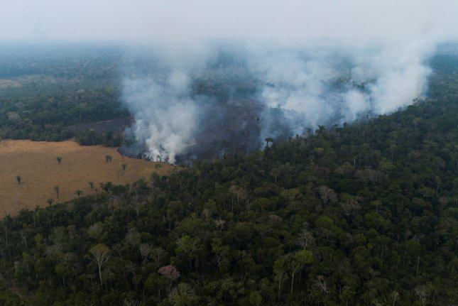 An aerial view shows a fire in the Amazon state of Rondonia, Brazil, on Saturday. Photo by Joedson Alves/EPA-EFE