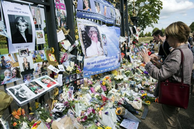 Tributes are left in memory of Diana, Princess of Wales, outside the gates of Kensington Palace in London on Thursday -- the 20th anniversary of her death. Photo by Will Oliver/EPA