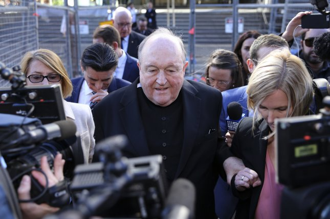 Archbishop Philip Wilson leaves the Newcastle Local Court in Newcastle, New South Wales, Australia, Tuesday after he was found guilty on four charges of concealing child sexual abuse in the 1970s. Photo by Peter Lorimer/EPA-EFE