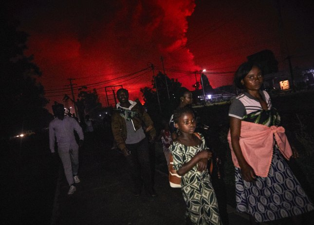 Congolese residents of Goma flee from Mount Nyiragongo volcano as it erupts over Goma, Democratic Republic of the Congo Saturday evening. File Photo by Kinsella Cunningham/EPA-EFE