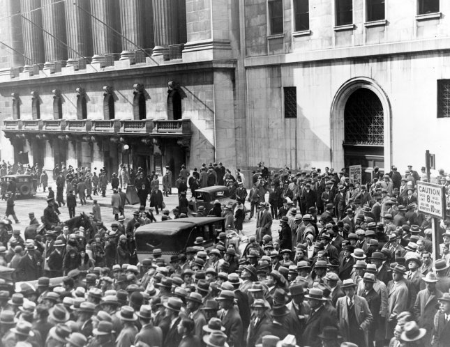 Crowd of people gather outside the New York Stock Exchange following the collapse of the financial markets on October 24, 1929. File Photo by Library of Congress/UPI