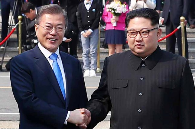 South Korean President Moon Jae-in (L) and his North Korean counterpart Kim Jong-un pose for a photo after the latter crossed the inter-Korean border for talks at the truce village of Panmunjom, South Korea, on Friday. The event marks the first time a North Korean leader has crossed the border into South Korea sine the end of hostilities during the Korean War. Photo by EPA-EFE/Yonhap