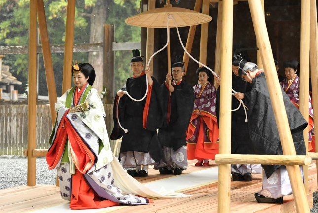 Japanese Empress Masako (L) attends a ritual at the Ise Grand Shrine of Geku on Friday with Emperor Naruhito (not pictured), in Ise, Mie Prefecture, Japan. Photo by Jiji/EPA-EFE/Pool