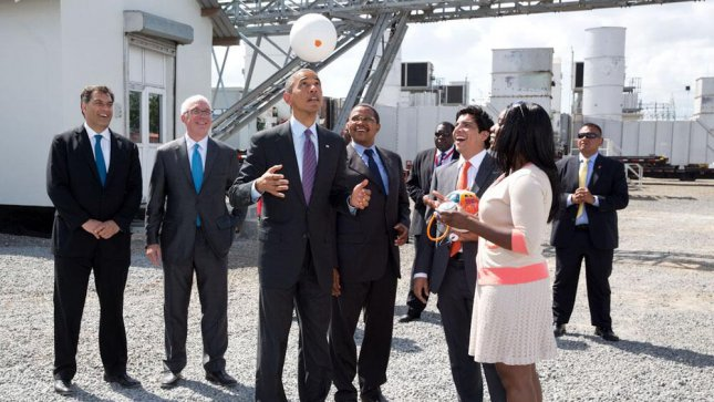 Obama plays with 'soccket' energy-creating soccer ball in Tanzania
