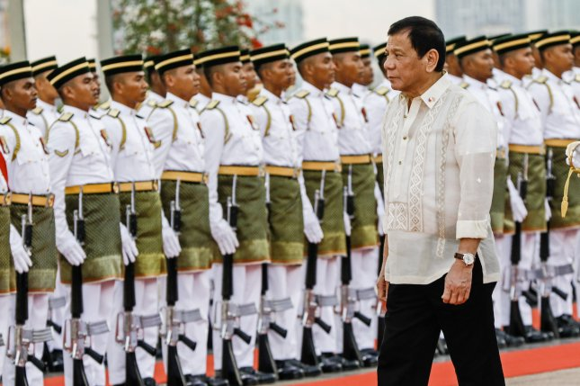 Filipino President Rodrigo Duterte inspects the guard of honor during a ceremony in Malaysia on November 10. Thursday, Duterte's government said it will honor a 2014 agreement to let the United States maintain temporary facilities at five military bases around the Philippines. File Photo by Ahmad Yusni/European Pressphoto Agency