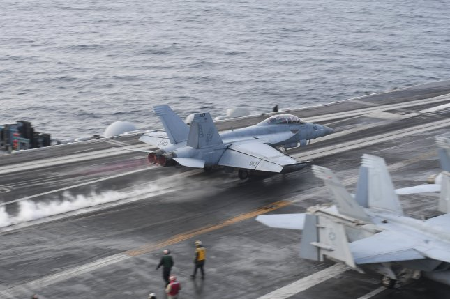 An F/A-18F Super Hornet takes off from the flight deck aboard the Nimitz-class aircraft carrier USS Harry S. Truman in the north Atlantic on Sept. 18. Photo by Mass Communication Specialist Seaman Joseph A.D. Phillips/U.S. Navy