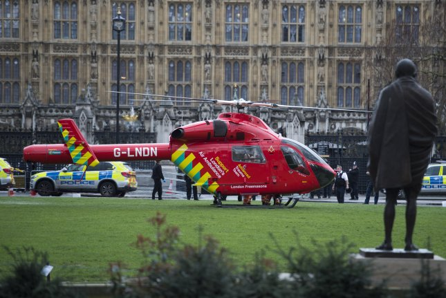Researchers say that air ambulances, such as the one pictured on Parliament Square in London in 2017, carry a high price but may not result in saving more lives. File Photo by Will Oliver/EPA