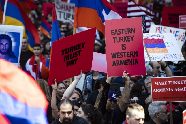 Activists rally to mark the 104th anniversary of the Armenian genocide at the Turkish consulate in Los Angeles, Calif., on April 24. File Photo by Etienne Laurent/EPA-EFE