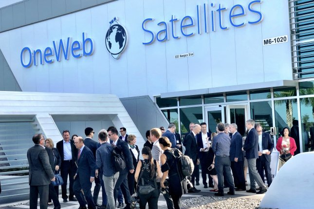 A crowd of executives, media and VIPs gathers for the opening of OneWeb Satellites' manufacturing facility in Florida in July 2019, but the fate of the plant is uncertain after the bankruptcy of its parent company, OneWeb. File Photo by Paul Brinkmann/UPI