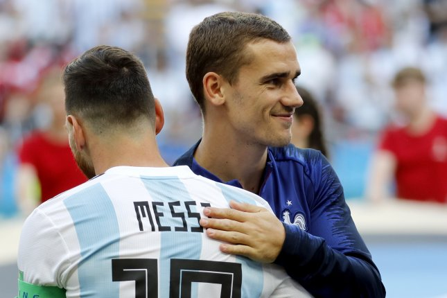 French soccer star Antoine Griezmann (R) and Lionel Messi will be teammates after FC Barcelona paid Griezmann's release clause and pried him away from rival La Liga club Atletico Madrid. Photo by Felipe Trueba/EPA-EFE