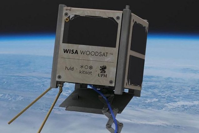 An illustration depicts the Woodsat satellite with wooden exterior in space. Photo courtesy of Arctic Astronautics