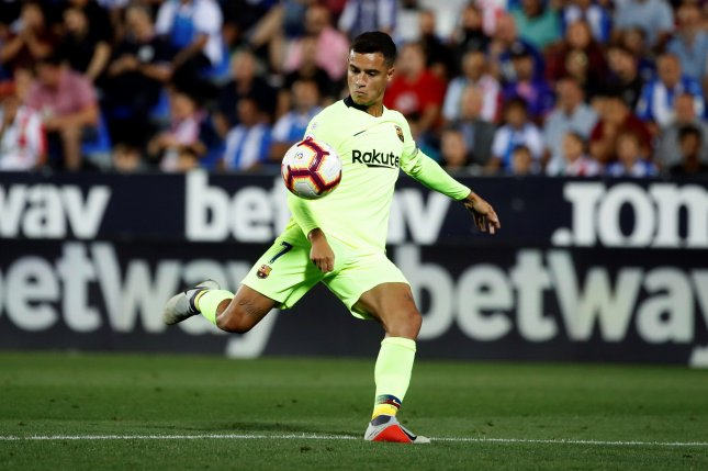 Pique mistake helps lowly Leganes shock Barcelona