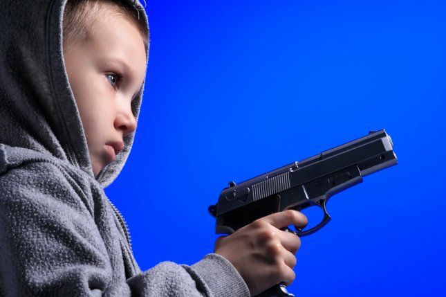 Image result for toddler holding gun