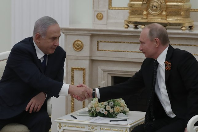 Russian President Vladimir Putin welcomes Israeli Prime Minister Benjamin Netanyahu at the Kremlin in Moscow, Russia, on May 9. Netanyahu returned Wednesday for his third meeting with Putin this year. File Photo by Sergei Ilnitsky/EPA-EFE