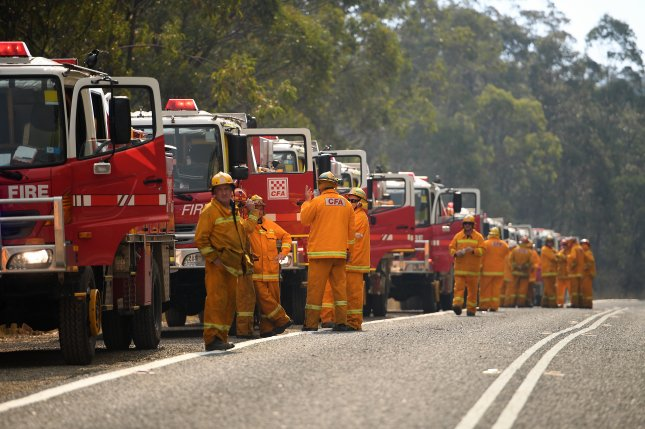 Fire crews prepare Wednesday to make containment lines to control a brush fire near Colo Heights, New South Wales, Australia. Photo by Dan Himbrechts/EPA-EFE