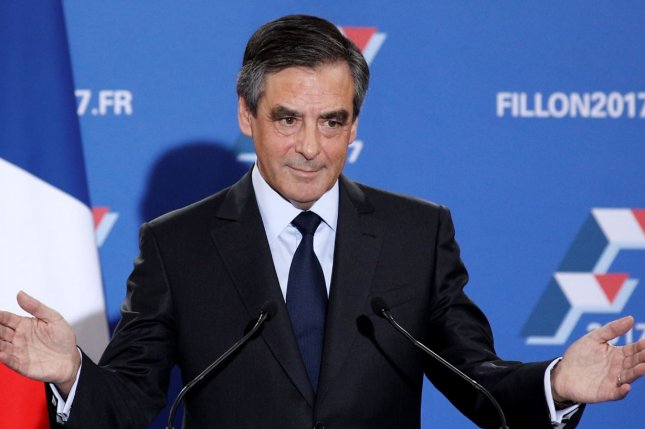 Francois Fillon said Wednesday he would continue in the French presidential race, despite the start of an investigation regarding whether he hired his wife for an allegedly non-existent job while he was a member of parliament. File Photo by Yoan Valat/European Press Agency