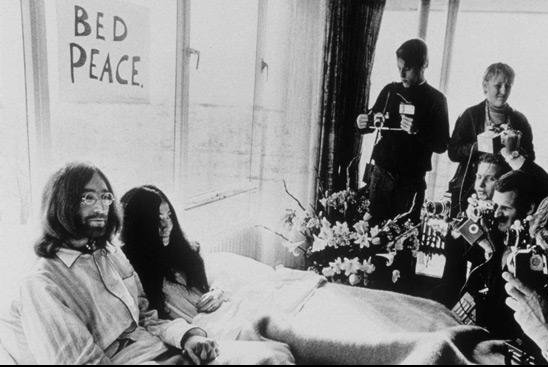 John Lennon and his wife, Yoko Ono, stage a bed-in for peace after their March 1969 wedding, a performance art honeymoon to protest the Vietnam War. Ono was given credit this week for helping to write Lennon's classic Imagine, 46 years after the song's release. File Photo by UPI