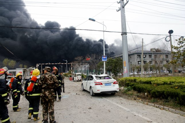 Rescuers pulled more bodies out of buildings near where a chemical plant exploded last week. Photo courtesy of EPA-EFE/STRINGER CHINA OUT