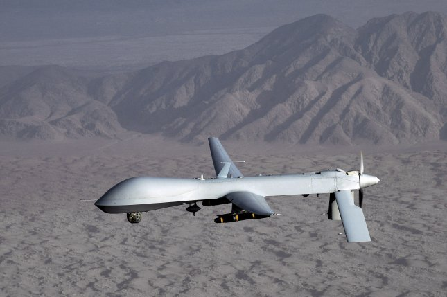 An undated picture by the US Air Force shows an MQ-1 Predator unmanned aircraft in flight at an undisclosed location. U.S. officials said Thursday it conducted a drone strike in the Nangarhar province of Afghanistan where 30 farmers were killed. Photo by Lt. Col. Leslie Pratt/EPA