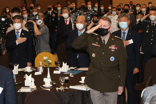 South Korean Defense Minister Jeong Kyeong-doo (L) and United States Forces Korea Commander Gen. Robert Abrams (R, front), salute their national flags at the 6th Korea-U.S. alliance forum at the defense ministry's convention center in Seoul, South Korea. File Photo by Yonhap South Korea/EPA-EFE