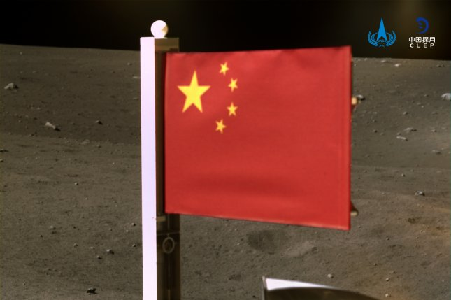 China's national flag was unfurled from the Chang'e-5 probe on the moon on Thursday. Photo courtesy of the China National Space Administration/EPA-EFE