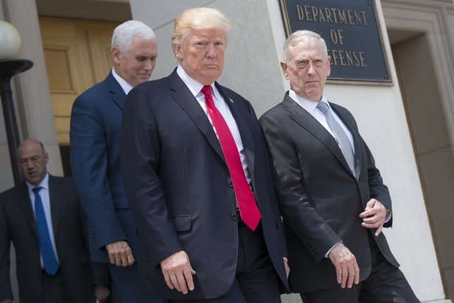 On Friday, 50 members of Congress sent a letter to Secretary of Defense Jim Mattis and Chairman of the Joint Chiefs of Staff Joseph Dunford asking they not enact a ban of transgender individuals serving in the military. Mattis (R) is pictured leaving a National Security Council meeting on July 20 with President Donald Trump (C) and Vice President Mike Pence. Photo by U.S. Navy Petty Officer 2nd Class Dominique A. Pineiro/Department of Defense