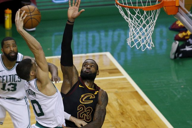 Boston Celtics forward Jayson Tatum (C) slam dunks the ball over Cleveland Cavaliers forward LeBron James (R) during the fourth quarter of Game 7 of the Eastern Conference finals Sunday at TD Garden in Boston. Photo by C.J. Gunther/EPA-EFE