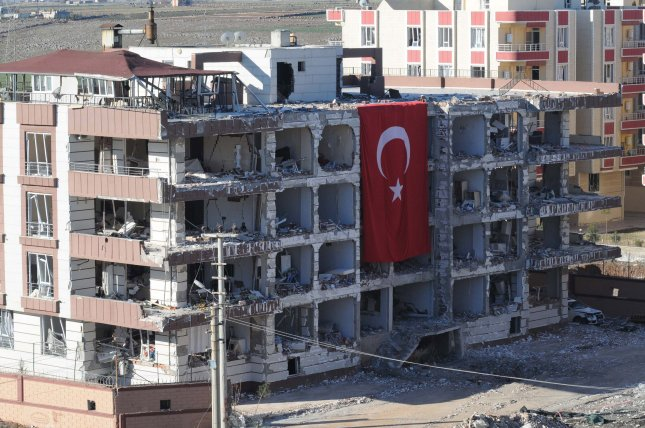 An 11-year-old boy and a security guard were killed in a car bombing near a building housing judges and prosecutors in Turkey. At least 15 people were injured, sustaining minor wounds, in the outhern city of Viransehir. Photo by Hasan Kirmizitas/EPA