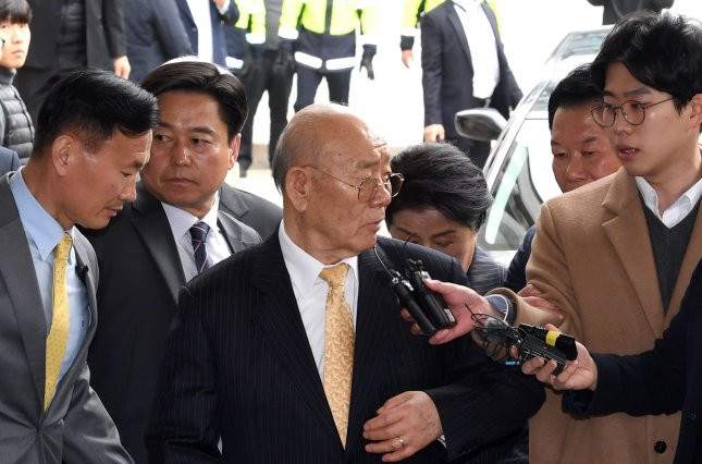 Former South Korean President Chun Doo-hwan (C) has declined to appear in court, citing Alzheimer's disease. File Photo by Yonhap