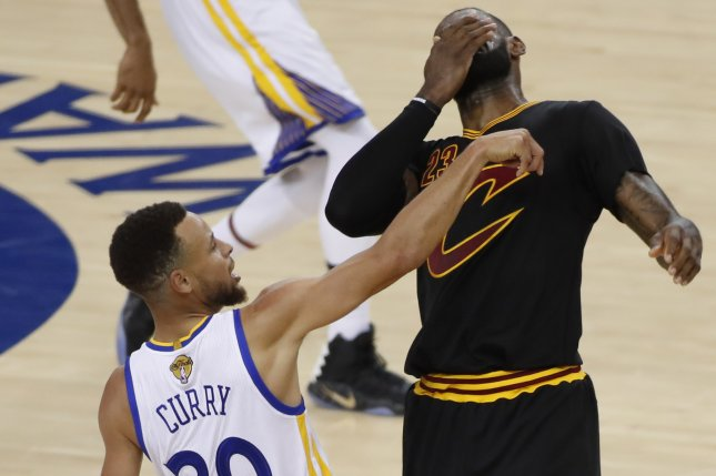 026b05af594c Golden State Warriors guard Stephen Curry (L) goes down against Cleveland  Cavaliers forward LeBron James (R) in the first half of Game 2 of the 2017  NBA ...