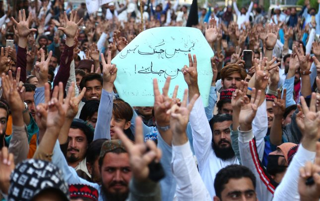 Supporters of Pashtun Tahaffuz Movement (PTM) hold placards reading in Urdu We need Peace not War as they shout slogans during a protest against the arrest of one of their leader Alamzeb Mehsud in Karachi, Pakistan. Photo by Shahzaib Akber/EPA-EFE